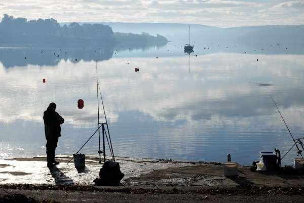 Man Fishing is Kingsbridge Estuary
