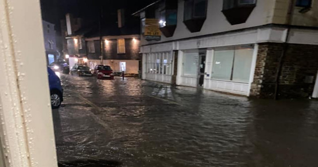 High tides and heavy rain came together to flood the centre of Kingsbridge